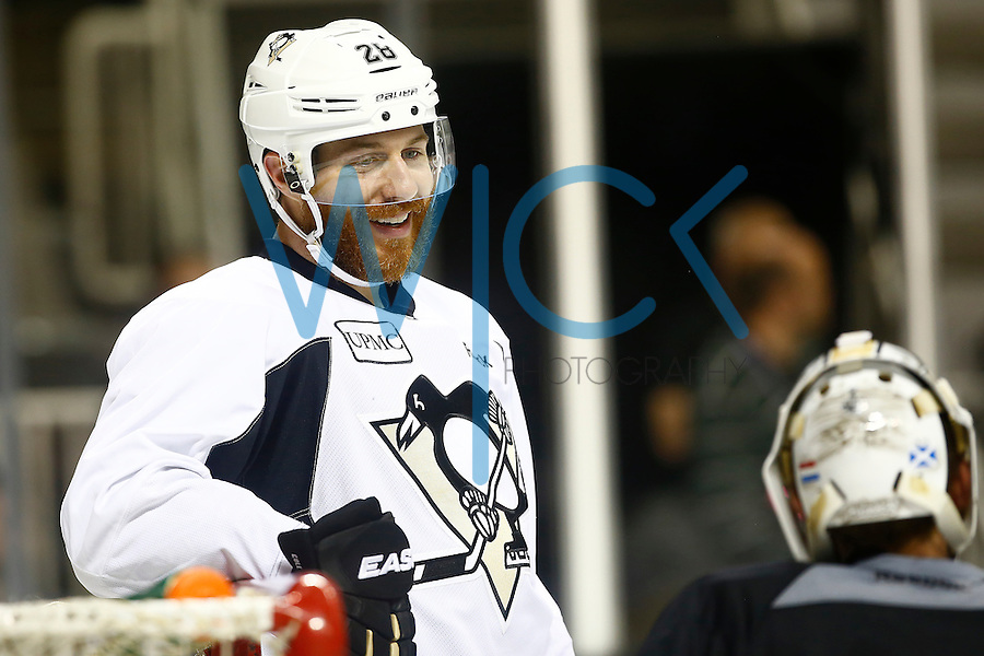 Ian Cole #28 of the Pittsburgh Penguins talks with Matt Murray #30 of the Pittsburgh Penguins during practice at the SAP Center in San Jose, California on June 5, 2016. (Photo by Jared Wickerham / DKPS)