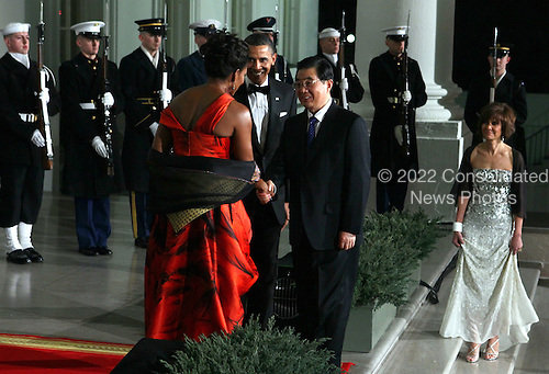 United States President Barack Obama (C) and first lady Michelle Obama (L) welcome President Hu Jintao of China for a State dinner at the White House, Wednesday, January 19, 2011 in Washington, DC. Obama and Hu met in the Oval Office earlier in the day. .Credit: Alex Wong / Pool via CNP