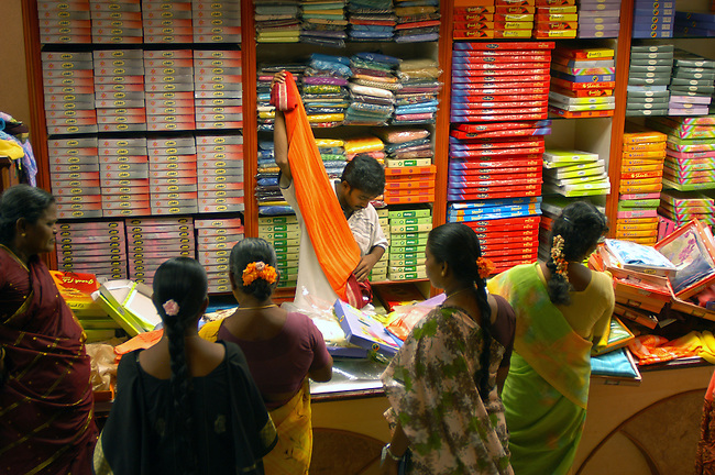 Women shop in a sari shop in Tirukoilur, Tamil Nadu,  India.