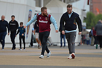 West Ham fans arrive on a windy day during West Ham United vs Manchester City, Premier League Football at The London Stadium on 10th August 2019