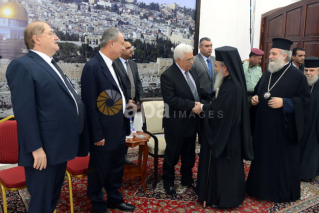 Palestinian President Mahmoud Abbas receives consolations of Arab business leader Said Khoury, who died at the age of 91, at Abbas's headquarter in the West Bank city of Ramallah, October 30, 2014. Palestinian businessman Said Khoury, founder and chairman of Consolidated Contractors Company (CCC), died aged 91 on October 16, 2014, in Athens. Photo by Thaer Ganaim