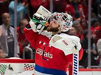 WASHINGTON, DC - JANUARY 31: Braden Holtby #70 of the Washington Capitals  takes a break during a game between New York Islanders and Washington Capitals at Capital One Arena on January 31, 2020 in Washington, DC.