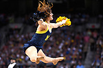 SAN ANTONIO, TX - APRIL 02:  A Michigan Wolverines cheerleader performs against the Villanova Wildcats in the 2018 NCAA Men's Final Four National Championship game at the Alamodome on April 2, 2018 in San Antonio, Texas.  (Photo by Jamie Schwaberow/NCAA Photos via Getty Images)