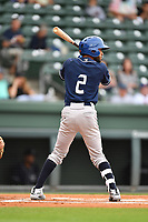 Second baseman Carlos Herrera (2) of Asheville Tourists bats in a game against the Greenville Drive on Wednesday, May 3, 2017, at Fluor Field at the West End in Greenville, South Carolina. Greenville won, 8-0. (Tom Priddy/Four Seam Images)