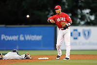 Second baseman Yoan Moncada (24) of the Greenville Drive turns a double play in a game against the Augusta GreenJackets on Thursday, June 11, 2015, at Fluor Field at the West End in Greenville, South Carolina. The Cuban-born 19-year-old Red Sox signee has been ranked the No. 1 international prospect in baseball by Baseball America. Greenville won, 10-1. (Tom Priddy/Four Seam Images)