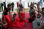 HARARE, ZIMBABWE - SEPTEMBER 26: Tanzania based designer Mustafa Hassanali at a fitting with models before a fashion show on September 26, 2014 at the Harare City library in Harare, Zimbabwe. Local and African and based designers showed their collections during the 5th edition of Zimbabwe Fashion week (Photo by: Per-Anders Pettersson)