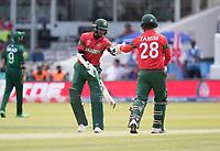 Tamim Iqbal (Bangladesh) and Shakib Al Hasan (Bangladesh) touch gloves during Pakistan vs Bangladesh, ICC World Cup Cricket at Lord's Cricket Ground on 5th July 2019