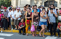 Lima, Peru.  Peruvian Spectators Watching an Andean Cultural Parade, Plaza de Armas.