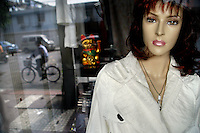 A mannequin stands in the window of a boutique clothing store in Nanjing, China.