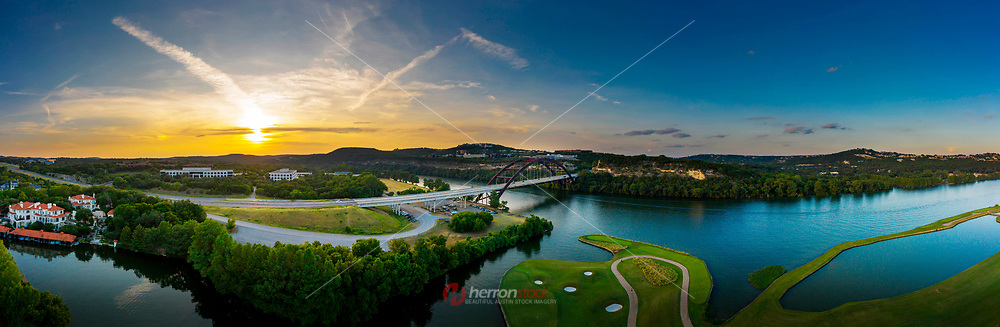 The 360 Pennybacker Bridge in Austin, Texas, is the showpiece of Austin, a through-arch bridge across Lake Austin which connects the northern and southern sections of the Loop 360 Capital of Texas Highway. The east side of the bridge overlooks the beautiful Austin Country Club golf course and offers stunning daily panoramic sunrise and sunset views from the cliffs adjoining the bridge.<br />