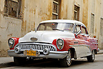 HAVANA - JANUARY 3: A vintage car parked in Havana, Cuba.  Legislation passed in 2011 has legalized car sales to all Cuban citizens who were previously restricted to owning pre-revolution vehicles.