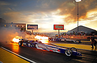 Mar. 30, 2012; Las Vegas, NV, USA: NHRA jet dragster drivers shoot flames out during qualifying for the Summitracing.com Nationals at The Strip in Las Vegas. Mandatory Credit: Mark J. Rebilas-US PRESSWIRE