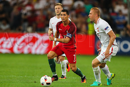 30.06.2016. Marseille, France. UEFA EURO 2016 quarter final match between Poland and Portugal at the Stade Velodrome in Marseille, France, 30 June 2016.   Cristiano Ronaldo (POR), Jakub Blaszczykowski (POL), Kamil Glik (POL)
