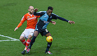 Gozie Ugwu of Wycombe Wanderers holds off Scott Cuthbert of Luton Town during the Sky Bet League 2 match between Wycombe Wanderers and Luton Town at Adams Park, High Wycombe, England on 6 February 2016. Photo by Kevin Prescod.