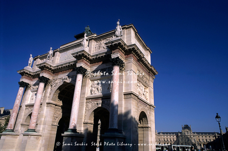 The Arc de Triomphe du Carrousel with the Louvre Museum in the background, Paris, France.