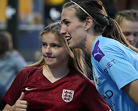 20191027 - Boreham Wood: Jill Scott is pictured posing with a young fan wearing England Women's National Team's jersey after the Barclays FA Women's Super League match between Arsenal Women and Manchester City Women on October 27, 2019 at Boreham Wood FC, England. PHOTO:  SPORTPIX.BE | SEVIL OKTEM