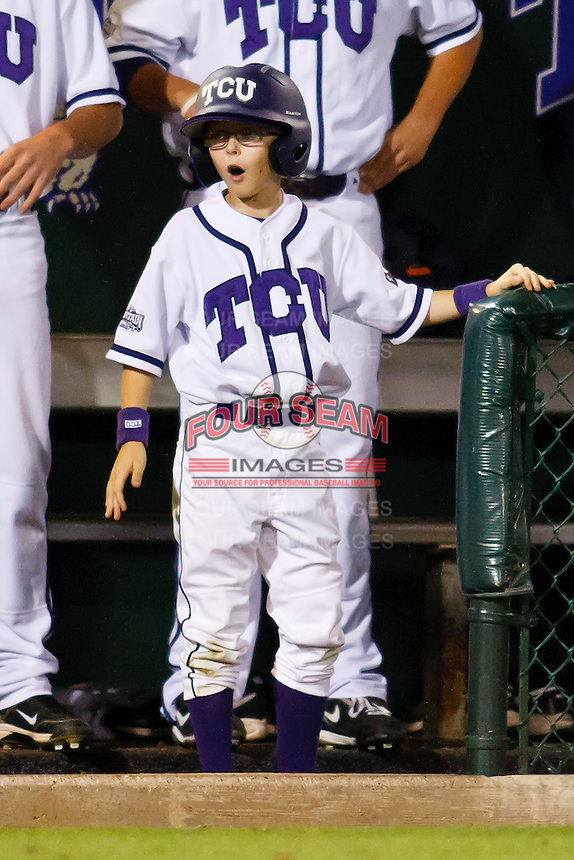 Excited TCU bat boy April 27th, 2010; NCAA Baseball action, Baylor University Bears vs TCU Horned Frogs at Lupton Stadium in Fort Worth, Tx;  TCU won 5-4 in extra innings.