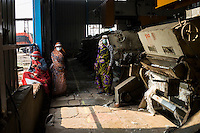 Workers working with the cotton ginning machines at a ginning factory contracted by Pratibha, a Fairtrade-certified establishment, in Maheshwar, Khargone, Madhya Pradesh, India on 13 November 2014. Photo by Suzanne Lee for Fairtrade