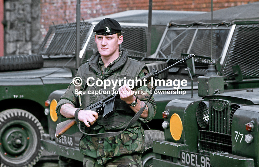 British soldier with rifle on duty in Belfast, N Ireland, September, 1971, 19710900431n<br /> <br /> Copyright Image from Victor Patterson,<br /> 54 Dorchester Park, Belfast, UK, BT9 6RJ<br /> <br /> t1: +44 28 90661296<br /> t2: +44 28 90022446<br /> m: +44 7802 353836<br /> <br /> e1: victorpatterson@me.com<br /> e2: victorpatterson@gmail.com<br /> <br /> For my Terms and Conditions of Use go to<br /> www.victorpatterson.com