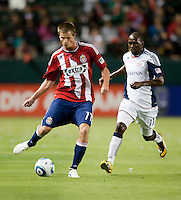 Chivas forward Justin Braun (17) moves past Revolution midfielder Kheli Dube (11) to make a pass during the first half of the game between Chivas USA and the New England Revolution at the Home Depot Center in Carson, CA, on September 10, 2010. Chivas USA 2, New England Revolution 0.