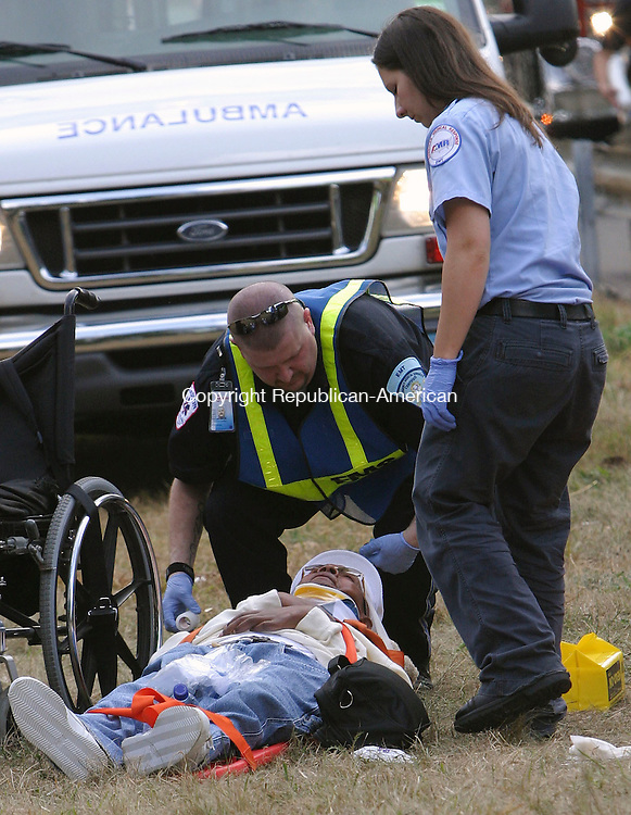 MIDDLEBURY, CT 10/05/07- 100507BZ05-  Emergency medical personnel tend to a victim of a Greyhound bus accident near the exit 17 off ramp of I-84 East in Middlebury Friday afternoon.   The accident, involving the bus and a tractor trailer, was reported in Waterbury prompting the Waterbury Fire Department to respond.  The Middlebury Volunteer Fire Department also responded.  The bus was traveling from New York City, NY to Boston, MA.<br /> Jamison C. Bazinet Republican-American