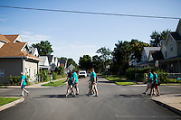 "Members make their way through the Hawthorne neighborhood during ""Circle the City with Service,"" the Kiwanis Circle K International's 2015 Large Scale Service Project, on Wednesday, June 24, 2015, in Indianapolis. (Photo by James Brosher)"