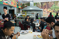 January 15, 2015 - Kuala Lumpur (Malaysia). Customers in one of the several restaurants owned by Global Ikhwan in the capital Kuala Lumpur. The enterprise, which employs 4,000 people worldwide through its complicated network of subsidiaries, operates restaurants, clothing shops, noodle factories and health clinics - just to name a few. It also runs its own schools, care homes and rehabilitation centres. © Thomas Cristofoletti / Ruom