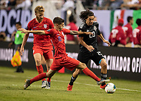 CHICAGO, IL - JULY 7: Rodolfo Pizarro #20 is defended by Christian Pulisic #10 during a game between Mexico and USMNT at Soldiers Field on July 7, 2019 in Chicago, Illinois.