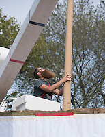 NWA Democrat-Gazette/J.T. WAMPLER Matt Long of Bentonville, works at installing a new flagpole Tuesday Sept. 22, 2015 in Bella Vista. A crew from Sign Studio placed the flagpole amid a cluster of nearly 30,000 pounds of rock that will bear a new sign welcoming people to Bella Vista. The letters will be backlit with LED lights that have the ability to change colors.