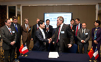 Shanghai Office of Financial Services Director-General Fang Xinghai (first row, left) and GDF Suez CEO and Paris Europlace Chairman Gerard Mestrallet (first row, right), shakes hands after signing a Memorandum of Understanding between Paris Europlace and Shanghai Financial Services, at Shanghai / Paris Europlace Financial Forum, in Shanghai, China, on December 1, 2010. Photo by Lucas Schifres/Pictobank