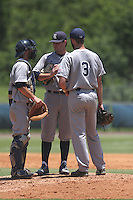 Starting pitcher Kevin McCanna (23) along with catcher, Hunter Kopycinski (4) and Connor Teyki (3) of the Rice University Owls have a meeting on the mound at FAU Baseball Stadium on May 9, 2015 in Boca Raton, Florida.  The Rice Owls defeated the FAU Owls 5-1.  (Stacy Jo Grant/Four Seam Images)