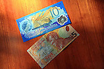New Zealand five and ten dollar currency bill on a table