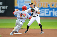 Erie Seawolves second baseman Hernan Perez #15 turns a double play as Steven Souza Jr #20 slides in during a game against the Harrisburg Senators on July 2, 2013 at Jerry Uht Park in Erie, Pennsylvania.  Erie defeated Harrisburg 2-1.  (Mike Janes/Four Seam Images)