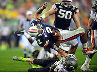 Jan 10, 2011; Glendale, AZ, USA; Auburn Tigers quarterback Cameron Newton (2) is tackled by Oregon Ducks safety John Boyett (20) during the second half of the 2011 BCS National Championship game at University of Phoenix Stadium.  Mandatory Credit: Mark J. Rebilas-