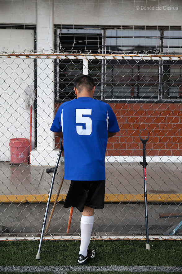 "Victor Hugo Bonilla Gonzalez, 32, a player from Guerreros Aztecas, portrayed during a training in Mexico City, Mexico on June 11, 2014. Victor lost his left leg after an assault in 2011. He is currently unemployed and he wants to be a DJ. Guerreros Aztecas (""Aztec Warriors"") is Mexico City's first amputee football team. Founded in July 2013 by five volunteers, they now have 23 players, seven of them have made the national team's shortlist to represent Mexico at this year's Amputee Soccer World Cup in Sinaloa this December. The team trains twice a week for weekend games with other teams. No prostheses are used, so field players missing a lower extremity can only play using crutches. Those missing an upper extremity play as goalkeepers. The teams play six per side with unlimited substitutions. Each half lasts 25 minutes. The causes of the amputations range from accidents to medical interventions – none of which have stopped the Guerreros Aztecas from continuing to play. The players' age, backgrounds and professions cover the full sweep of Mexican society, and they are united by the will to keep their heads held high in a country where discrimination against the disabled remains widespread. (Photo by Bénédicte Desrus)"
