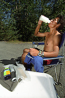 A racer stops to refuel at the end of the 38-mile Resurrection Pass Trail during the 2004 Resurrection Pass Trail 100-Miler and 50-Miler ultramarathons.
