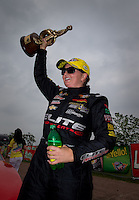 Apr 27, 2014; Baytown, TX, USA; NHRA pro stock driver Erica Enders-Stevens celebrates after winning the Spring Nationals at Royal Purple Raceway. Mandatory Credit: Mark J. Rebilas-USA TODAY Sports