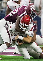 Hawgs Illustrated/Ben Goff<br /> Otaro Alaka, Texas A&M linebacker, sacks Ty Storey, Arkansas quarterback, in the 3rd quarter Saturday, Sept. 29, 2018, during the Southwest Classic at AT&T Stadium in Arlington, Texas.