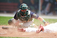 Vermont Lake Monsters catcher Brett Sunde (24) attempts to tag Dalton Dulin (1) sliding home safely during a game against the Auburn Doubledays on July 13, 2016 at Falcon Park in Auburn, New York.  Auburn defeated Vermont 8-4.  (Mike Janes/Four Seam Images)