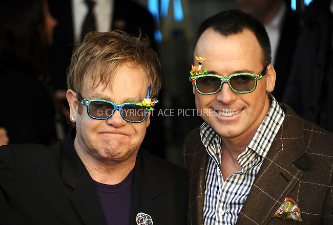"""WWW.ACEPIXS.COM . . . . .  ..... . . . . US SALES ONLY . . . . .....January 30 2011, London....Elton John and David Furnish at the UK film premiere of """"Gnomeo & Juliet"""" at the Odeon Leicester Square on January 30 2011 in London....Please byline: FAMOUS-ACE PICTURES... . . . .  ....Ace Pictures, Inc:  ..Tel: (212) 243-8787..e-mail: info@acepixs.com..web: http://www.acepixs.com"""