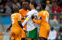 Cristiano Ronaldo of Portugal and Guy Demel of the Ivory Coast clash leading to yellow cards for both players