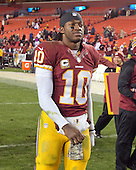 Washington Redskins quarterback Robert Griffin III (10) leaves the field following his team's 27 - 6 loss to the San Francisco 49ers at FedEx Field in Landover, Maryland.<br /> Credit: Ron Sachs / CNP