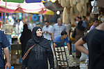 A woman walks in the market in the Zeitoun neighborhood of Gaza City, Gaza. Residents of the Palestinian territory are still reeling from the death and destruction of the 2014 war with Israel, and the continuing siege of the seaside territory by the Israeli military.