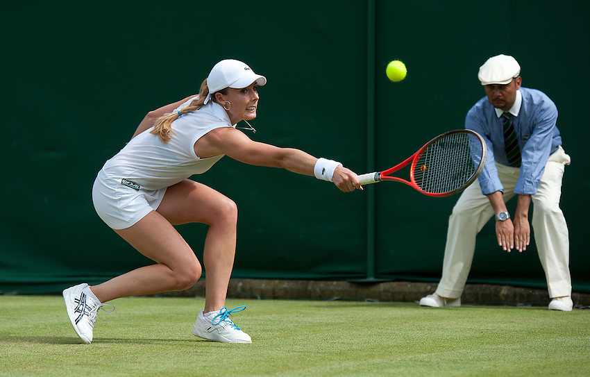 Alize Cornet FRA in action today during her defeat by Tamira Paszek AUT in their Ladies' Singles Second Round match - Tamira Paszek AUT def Alize Cornet FRA 6-2 6-1..Tennis - Wimbledon Lawn Tennis Championships - Day 4 - Thursday 28th June 2012 -  All England Lawn Tennis and Croquet Club - Wimbledon - London - England..© CameraSport - 43 Linden Ave. Countesthorpe. Leicester. England. LE8 5PG - Tel: +44 (0) 116 277 4147 - admin@camerasport.com - www.camerasport.com.