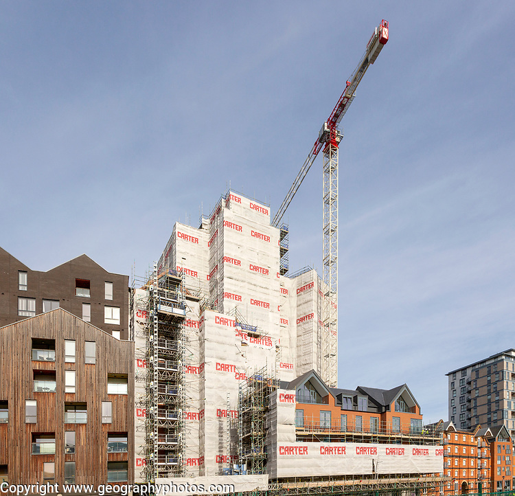 Work recommenced on the 'Wine Rack' building on the waterfront, Ipswich, Suffolk, England, UK - a property development stalled by the financial crash and again underway February 2019