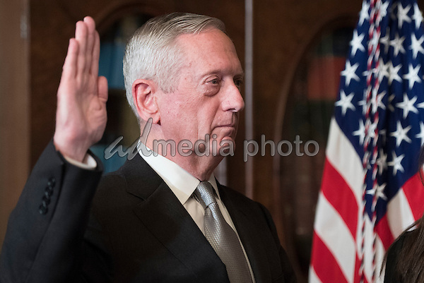 Marine Corps General James Mattis is sworn-in as Defense Secretary by Vice President Mike Pence (not pictures), in the Vice Presidential ceremonial office in the Executive Office Building in Washington, D.C. on January 20, 2017. Photo Credit: Kevin Dietsch/CNP/AdMedia