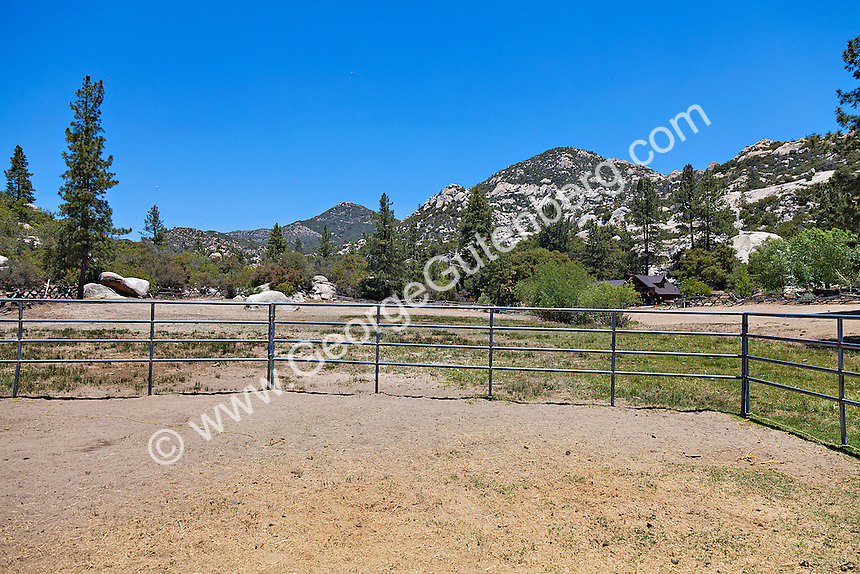 Pipe corral at rustic mountain ranch