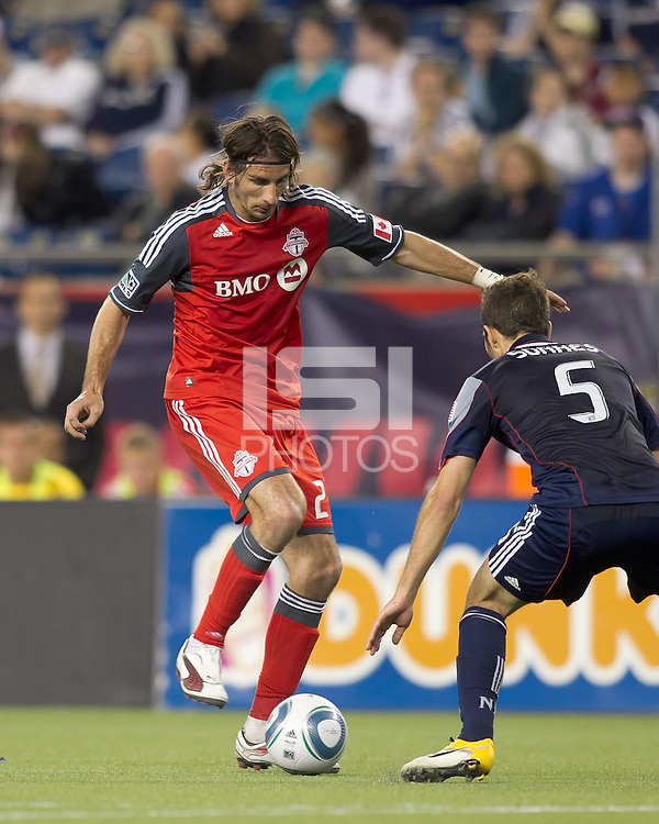 Toronto FC forward Alan Gordon (21) dribbles as New England Revolution defender A.J. Soares (5) defends. In a Major League Soccer (MLS) match, the New England Revolution tied Toronto FC, 0-0, at Gillette Stadium on June 15, 2011.