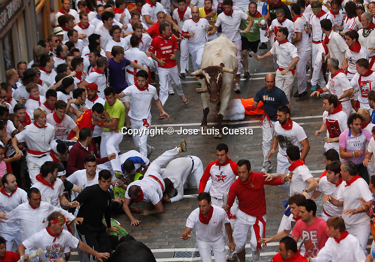 Second day of bull run in Estafeta street, Pamplona, northern of Spain.  San Fermin festival is worldwide known because the daily running bulls.