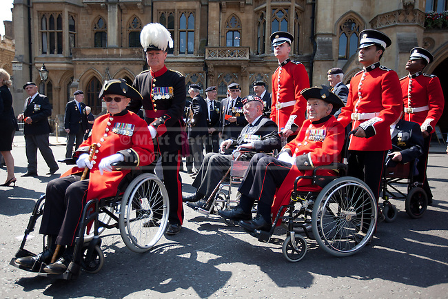 11/07/2013. London, UK. Chelsea Pensioners, all British veterans of the Korean War, are seen outside Westminster Abbey in London today (11/07/2013). The parade and service held to commemorate the 60th Anniversary of the end of the Korean War, often known as the 'Forgotten War', which saw a United Nations force of many nations fight against North Korean and Chinese forces trying to invade South Korea. Photo credit: Matt Cetti-Roberts